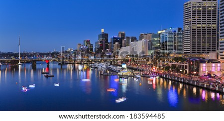 Australia sydney Darling Harbour sunset panorama vividly illuminated city landmarks with reflection in harbour water