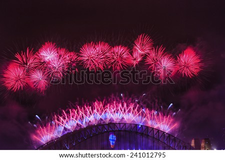 Australia Sydney Harbour bridge arch highlighted by New Year Fireworks bright red light balls and pyrotechnics - stock photo