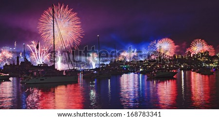 Australia Sydney Harbour water fireworks New Year eve over anchored boats fire balls and light show lasers in the sky - stock photo