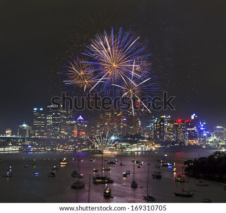 Australia Sydney New Year firework balls over harbour reflecting in the water with yachts