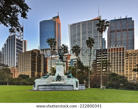 Australia Sydney NSW Royal Botanic Garden view on Captain Arthur Philip statue fountain and city CBD skyscrapers - stock photo