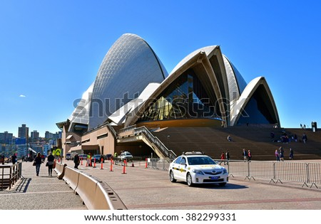 Australia-Sydney,2015.Opera House from the front with visible staircase and a part of the boulevard with tourists. Editorial. Horizontal view. - stock photo