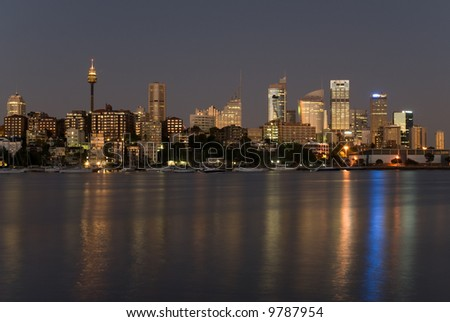 Australia, Sydney seafront with sky-scrapers, yachts at night