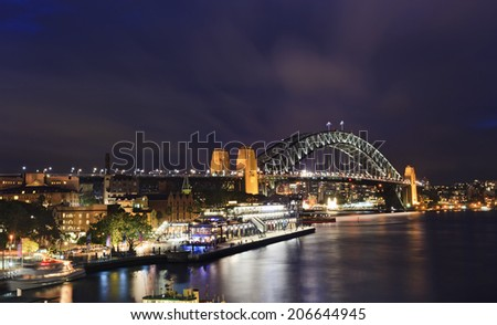 Australia Sydney view from circular quay at Harbour bridge at sunset illuminated city landmarks