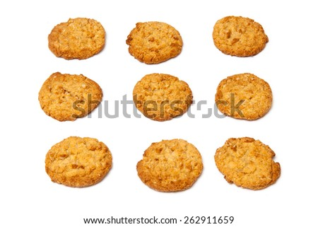 Australian and New Zealand Army Corps (ANZAC)  biscuits isolated on a white background. They are made using rolled oats, flour, desiccated coconut, sugar, butter, golden syrup, baking soda and water. - stock photo