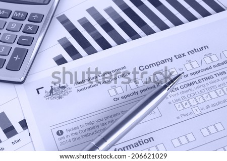 Australian annual company tax return with spreadsheet graph and calculator in blue tint