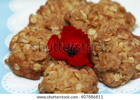 Australian Anzac biscuits with red poppies - stock photo
