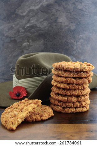 Australian Anzac biscuits with soldier slouch hat on dark vintage background.  - stock photo