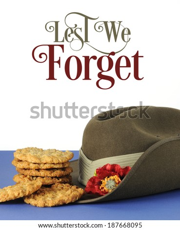 Australian army slouch hat and traditional Anzac biscuits on white and blue background for Anzac Day, April 25, or Remembrance Armistice Day, November 11, with Lest We Forget sample text. - stock photo