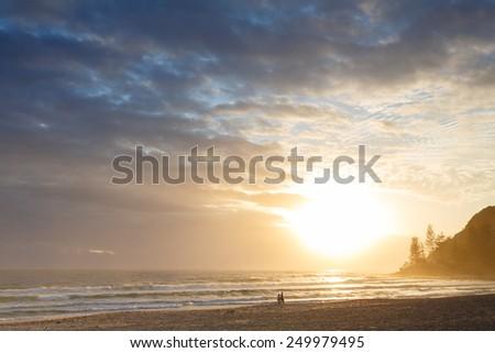 Australian beach at sunrise (Gold Coast, Burleigh Heads, QLD, Australia) - stock photo