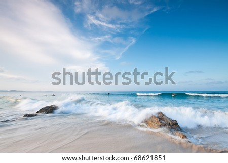 australian beach during the day with big cloud formation in background - stock photo