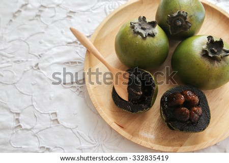 Australian Black Sapote or Chocolate Pudding Fruit  - stock photo