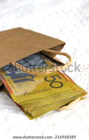 Australian Cash in a Brown Paper Bag - stock photo