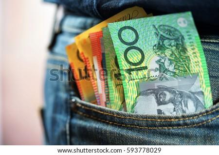 Australian cash money in mans jeans pocket, close up.