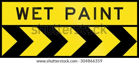 Australian chevron alignment pointing to the right with the words: Wet paint - stock photo