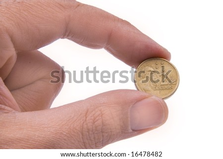 Australian $2 coin held by two fingers and isolated on white background