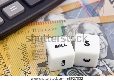 Australian currency with calculator and dice showing SELL - stock photo