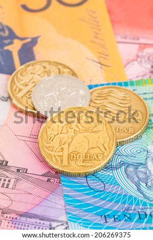 Australian dollar banknotes and coins - stock photo