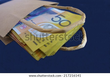 Australian Fifty Dollar Notes in a Brown Paper Bag - stock photo