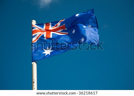 Australian flag against blue sky - stock photo