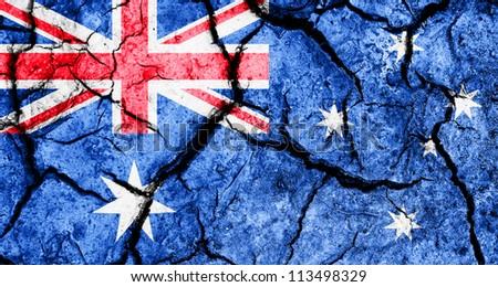 Australian flag on cracked earth background - stock photo