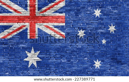 Australian flag over old brick wall - stock photo
