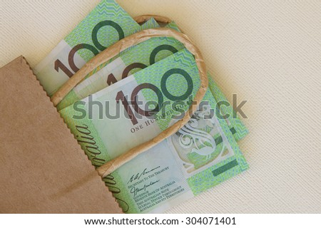 Australian Hundred Dollar Notes in a Bag - stock photo