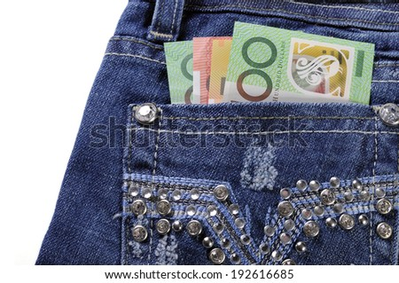 Australian hundred, fifty and twenty dollar notes in back pocket of feminine ladies rhinestone decorated jeans, for money in the pocket concept image - stock photo