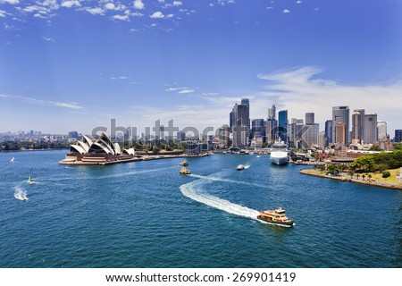 australian major landmarks in Sydney - cityscape of city CBD view from Harbour Bridge across harbour waters on a sunny summer day - stock photo
