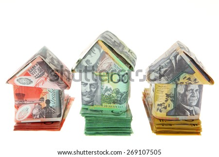 Australian Money - Aussie currency houses on stacks of money - first second and third - stock photo