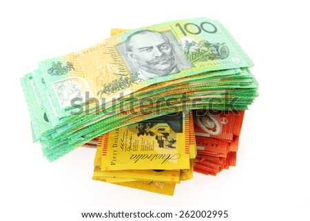 Australian Money - Aussie currency sorted into stacks on white background - stock photo