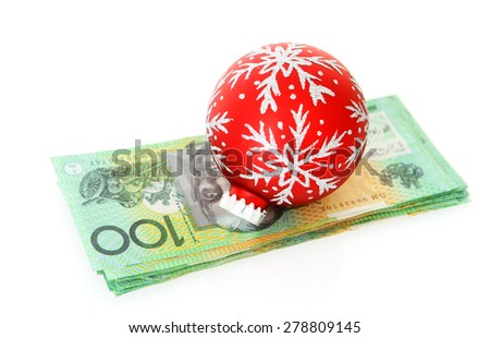 Australian Money - Aussie currency with Christmas bauble - stock photo