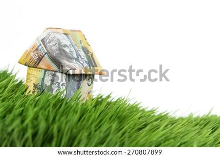 Australian money house on grass - stock photo