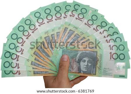 Australian money with hand - stock photo