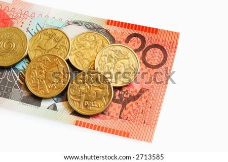 Australian One Dollar Coins on a Twenty Dollar Note. - stock photo