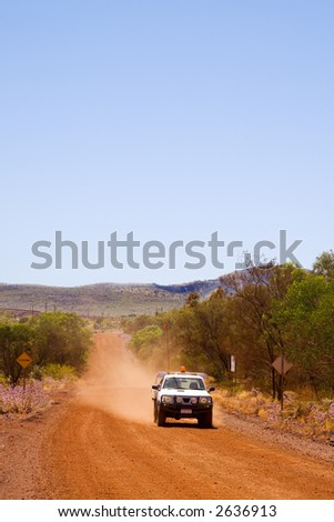 Australian outback road near Tom Price, Western Australia, and 4X4 ute