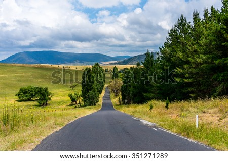 Australian outback road. Unmarked rural road on overcast day. Lithgow region, Blue Mountains, NSW, Australia - stock photo