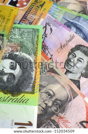 Australian paper money, including one hundred, twenty, ten, five and fifty dollar notes against a black background. Vertical. - stock photo