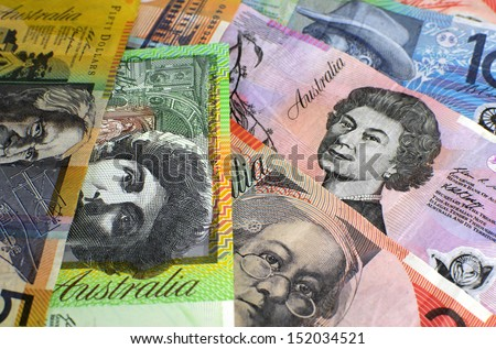 Australian paper money, including one hundred, twenty, ten, five and fifty dollar notes against a black background. - stock photo