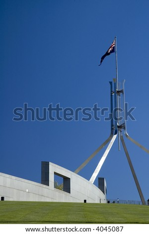Australian Parliament House in Canberra, australian flag, clear blue sky - stock photo