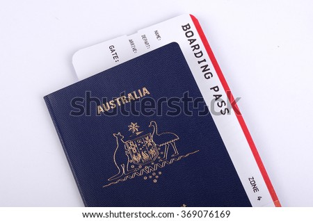 Australian passport with a boarding pass inside - stock photo