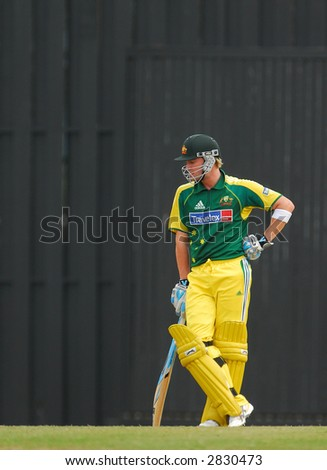 Australian player in actions during the final of their tri-nations cricket series in Kuala Lumpur - stock photo