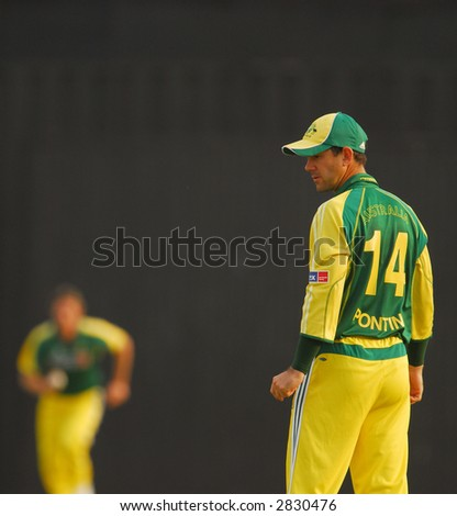 Australian players in action during the final of their tri-nations cricket series in Kuala Lumpur - stock photo
