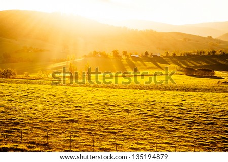 Australian sunset over a farm - stock photo