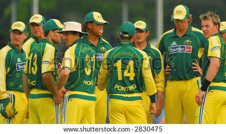 Australian teammates in action during the final of their tri-nations cricket series in Kuala Lumpur - stock photo