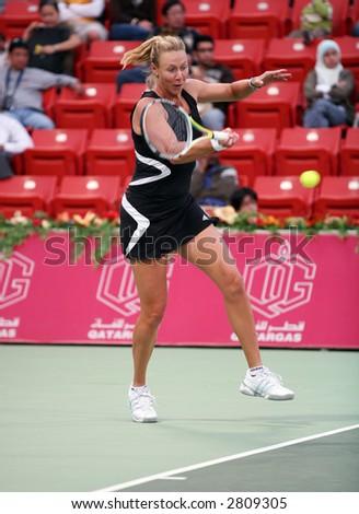 Australian tennis star Alicia Molik in action against Justine Henin, at the Qatar Total Open, Doha, February 28, 2007. - stock photo