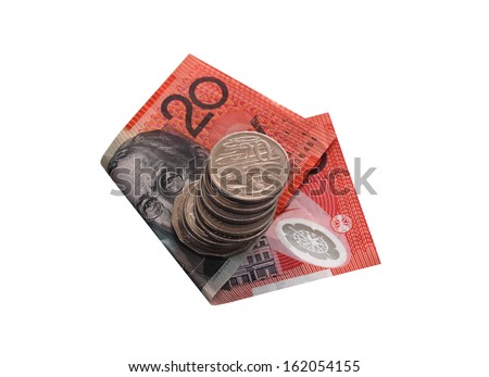 Australian twenty dollar note with a pile of silver coins. Note focus on top twenty cent coin. - stock photo
