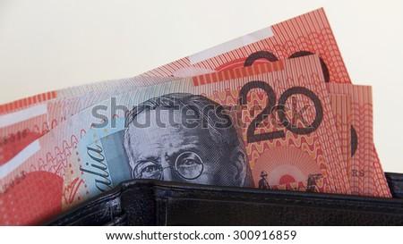 Australian Twenty Dollar Notes in a Black Wallet - stock photo
