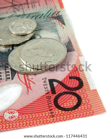 australian twenty dollars note and coins on white - stock photo
