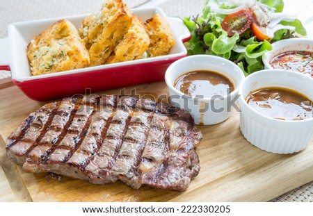 australian wagyu rib-eye beef steak serve with fresh vegetable - stock photo